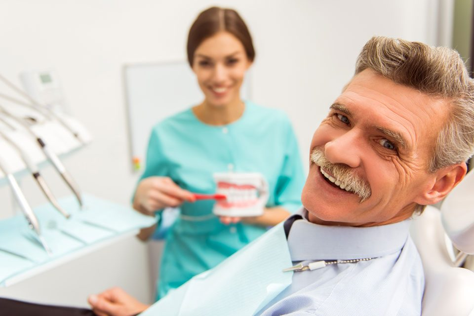 Photo of a man looking for dental implant dentist