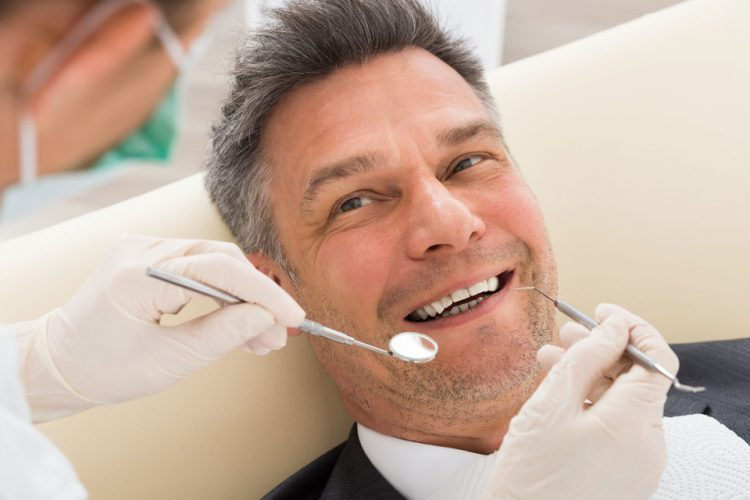 photo of a man having his teeth checked at a milton dentist